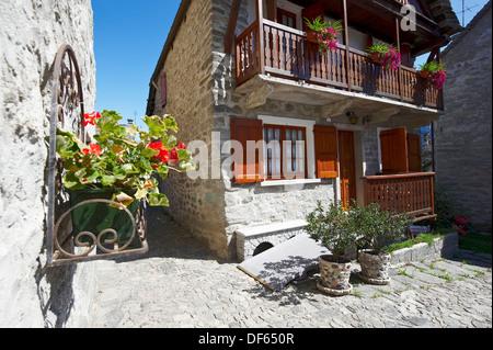 A traditional alpine home made of stone and wood in Viceno di Crodo, a small village in Verbano-Cusio-Ossola Province - Stock Photo