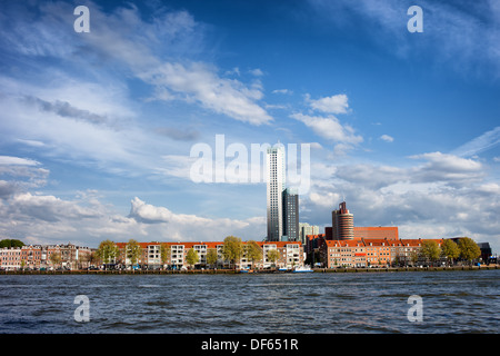 Terraced houses skyline along New Meuse (Dutch: Nieuwe Maas) river in Rotterdam city centre, Netherlands. - Stock Photo