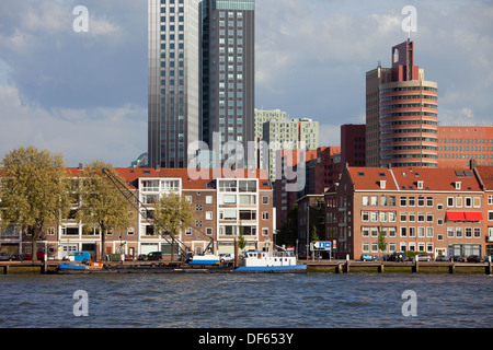 Terraced houses along New Meuse (Dutch: Nieuwe Maas) river and office buildings in the background in Rotterdam, - Stock Photo