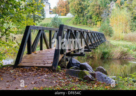 Wooden foot bridge with trees. In Lithuania - Stock Photo