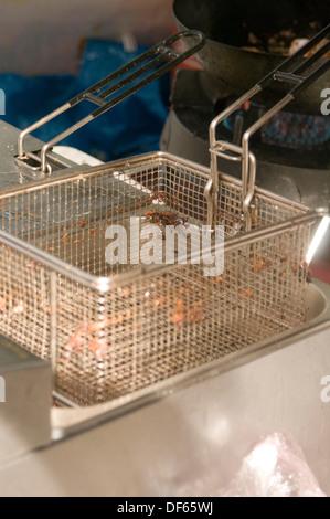 deep fried food fast fry vat basket foods chip chips baskets oil fat fryer fryers fryalator frialator flying in - Stock Photo