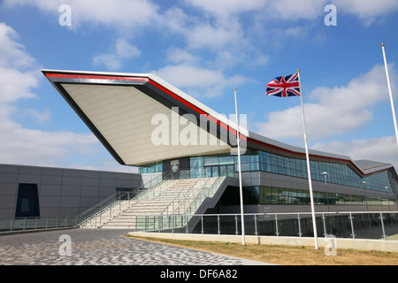 The Wing Building at Silverstone Racing Circuit with Union Jack flag flying against a blue sky. - Stock Photo