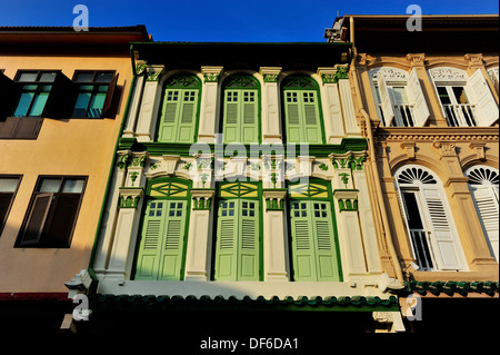 Rows of conserved shophouses in Singapore - Stock Photo