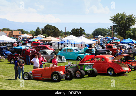 Spectators at a Classic Car show near Grand Junction, Colorado looking at customised and collectable automobiles. - Stock Photo