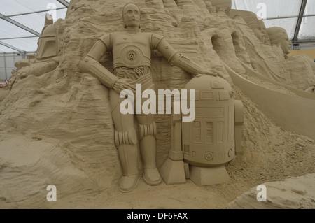 sci fi sand sculpture - Stock Photo