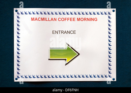 Sign pointing the way to a Macmillan Cancer Support Coffee Morning, Farnham, Surrey, UK. - Stock Photo