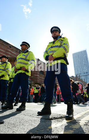 Manchester, UK. 29th Sept 2013. A policeman on Deansgate during a North West TUC organised march and rally intending - Stock Photo