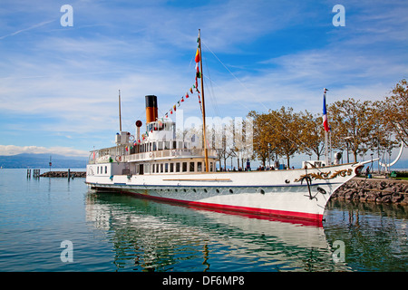 Vintage steam boat near the pier on the lake Leman (Switzerland) - Stock Photo