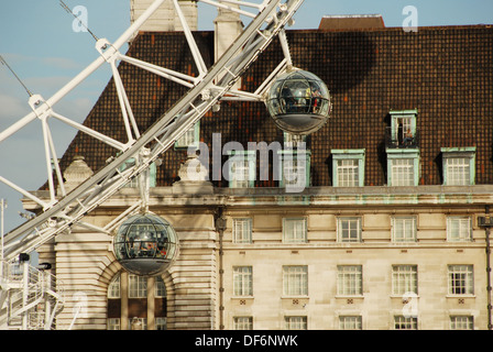 London Eye capsules in front of The County Hall. Partial façade. Queen's Walk, South Bank, London, England, Great - Stock Photo