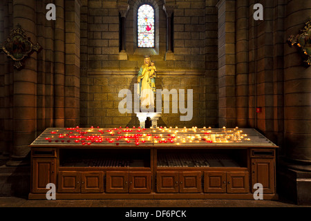Burning candles in front of Virgin Mary with baby Jesus sculpture as part of Saint Nicolas Cathedral in Monaco-Ville, - Stock Photo