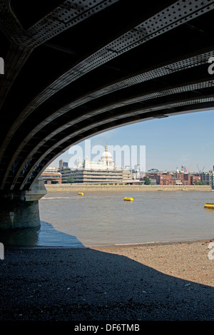 A view of St Paul's Cathedral from under Blackfriars Bridge London, England, UK. - Stock Photo
