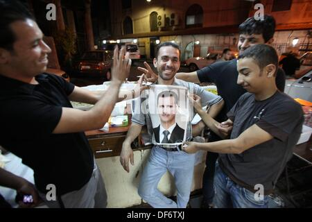 Young people in the street support Syrian President Bashar al-Assad, Damascus, Syria, on 2013-09-29. They say: 'God, - Stock Photo