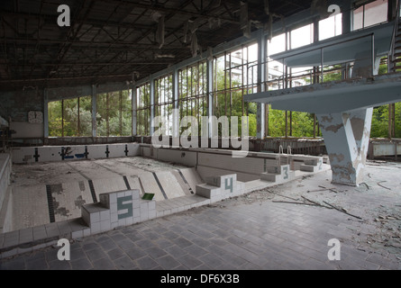 The abandoned swimming pool in the ghost town of Pripyat, Ukraine. - Stock Photo