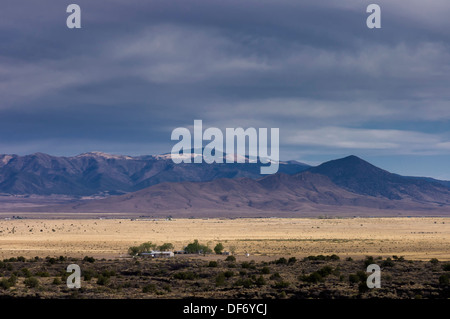 ranch in the Valley of Fires or Malpais area by a stormy day ,New Mexico, USA - Stock Photo