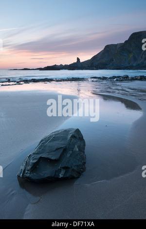 A colourful sunset at Hartland Quay Beach, North Devon, UK. - Stock Photo