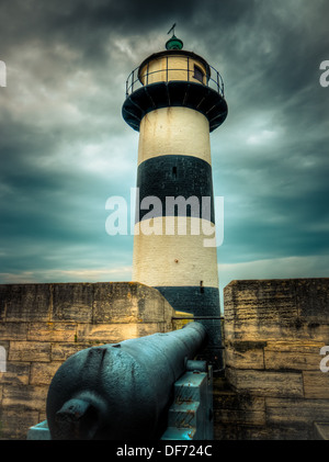 The Lighthouse of Southsea castle in Portsmouth, Hampshire, England, on a dark and cloudy day - Stock Photo