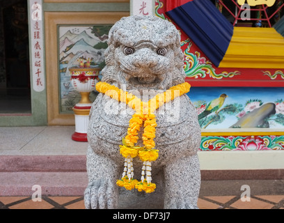 Chinese lion ('foo dog') statue at Sala Jao Phu Ya Chinese temple in Nong Khai, Thailand - Stock Photo
