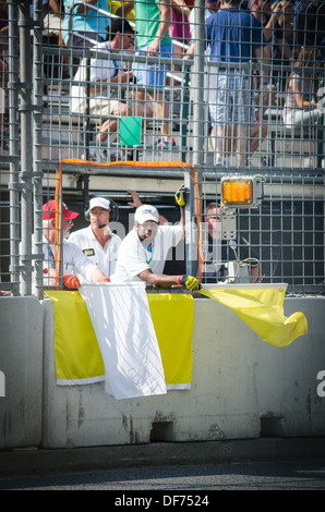 Yellow Flags being waved at the Baltimore Grand Prix - Stock Photo