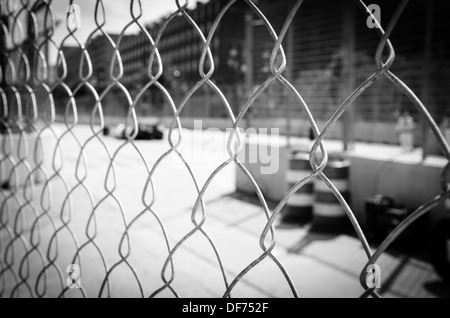 Behind the chain link fence at the Baltimore Grand Prix - Stock Photo