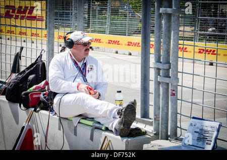 Race Marshal relaxing at the Baltimore Grand Prix - Stock Photo