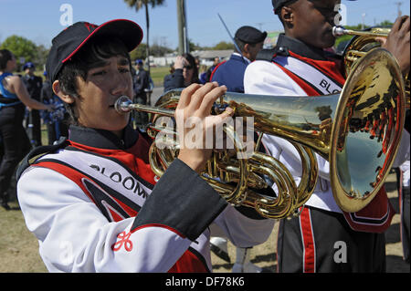 High School Band Member plays french horn at Strawberry Festival Parade Plant City Florida - Stock Photo