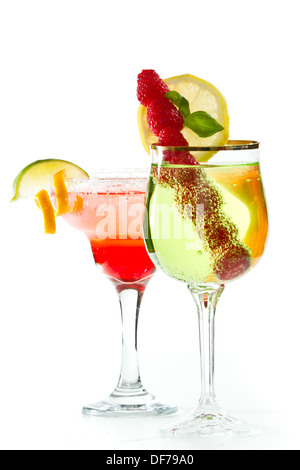 refreshing fruity cocktails isolated on a white background garnished with a lime and an orange twist - Stock Photo