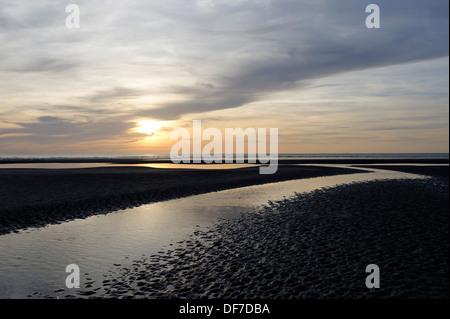 Sunset over a beach at low tide, English Channel, Côte d´Opale, Le Touquet-Paris-Plage, Département Pas-de-Calais - Stock Photo