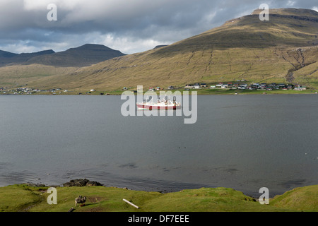 Fishing boats in a fjord, Sundini fjord, Streymoy, Faroe Islands, Denmark - Stock Photo