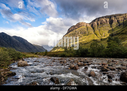 Late afternoon light on river Coe and the Tree Sisters in Glen Coe - Stock Photo