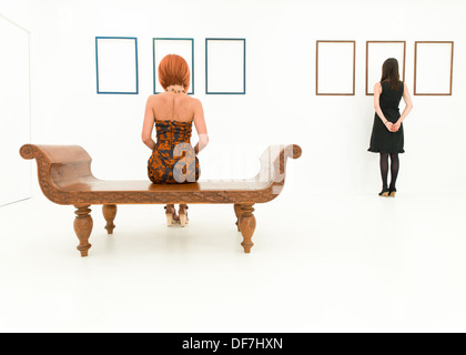 walls in museum with empty frames and person looking Stock Photo ...