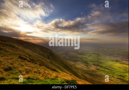 A sunrise taken from the height of the Clachan of Campsie fells in Lennoxtown. golden light land view of glasgow - Stock Photo
