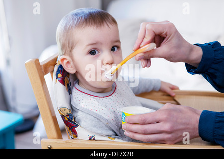 CHILD EATING A MEAL - Stock Photo