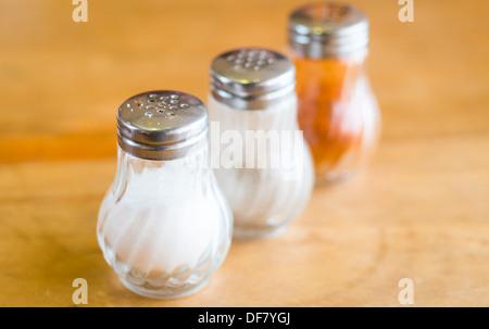 shaker glass bottle of salt and pepper for garnish food - Stock Photo