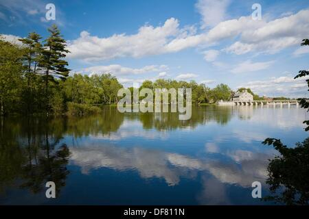 The Des Mille-Iles River and the New Mill on Ile des Moulins Historic Site at Springtime, Old Terrebonne, Lanaudiere, - Stock Photo