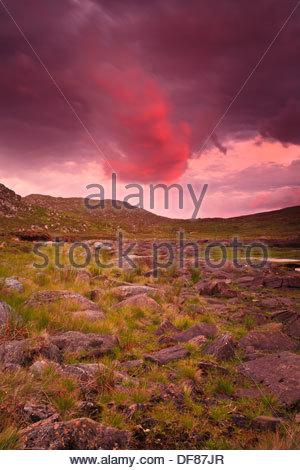 Colorful evening skies above the island Runde in Herøy kommune, Møre og Romsdal, Norway. - Stock Photo