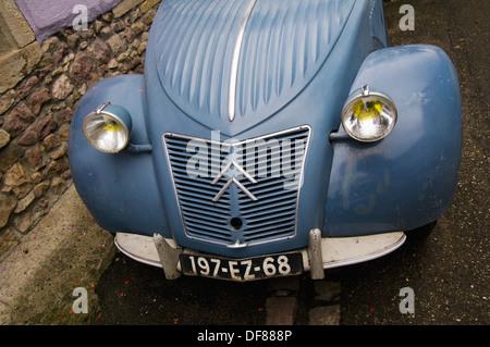 Bonnet, headlights and registration plate of an old Citroen 2CV, vintage car, Soultzmatt, Alsace, France - Stock Photo