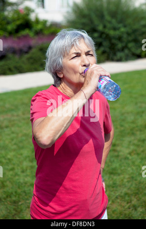 THIRSTY ELDERLY PERSON - Stock Photo