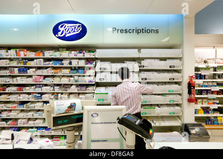 Boots the Chemist, the pharmacist working in the pharmacy, UK - Stock Photo