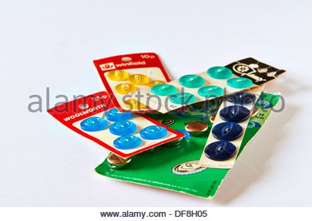 selection of cards of assorted multi-coloured buttons - Stock Photo