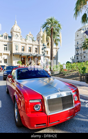 Europe, France, Principality of Monaco, Monte Carlo. Luxury cars front of casino. - Stock Photo