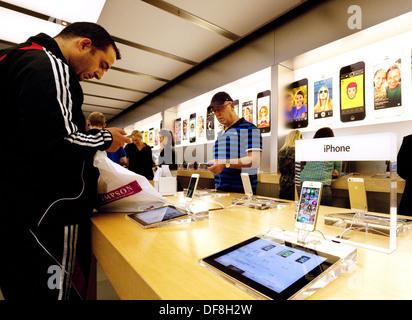 The iPhone 5S on sale in the Apple store interior, Grand arcade Cambridge UK - Stock Photo