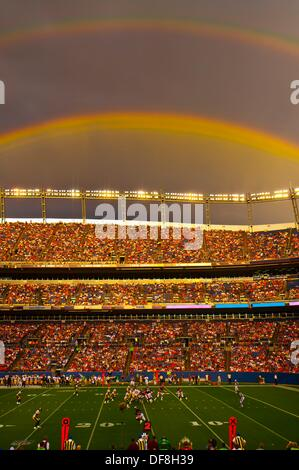 A rainbow over the stadium, Denver Broncos vs. Pittsburgh Steelers NFL football game, Invesco Field at Mile High - Stock Photo
