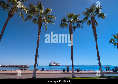 Looking from the Malicon, Loreto to the Holland America Line cruise ship ´Ryndam´ anchored off shore, Sea of Cortes, - Stock Photo