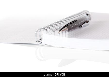 Stationery set. Blank notebook and pen isolated on white background - Stock Photo