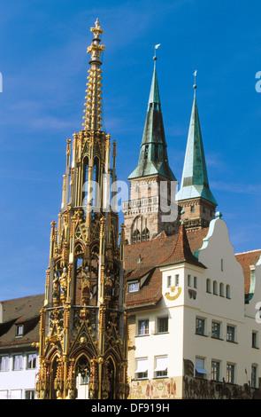 Schöner Brunnen (The ´Beautiful Fountain´), Hauptmarkt and Sebalduskirche (Saint Sebald Church). Nürnberg. Bavaria. - Stock Photo