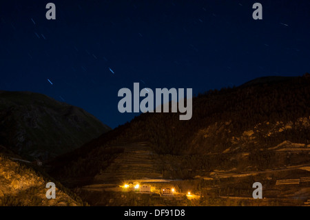 houses on the high mountain with the background stars in Andorra La Vella - Stock Photo