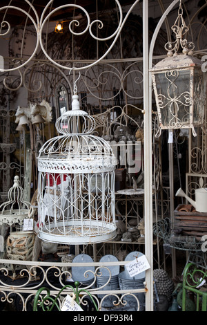 Vintage bird cage and garden furniture on display, Abbey Furniture, Walcot Street, Bath, England