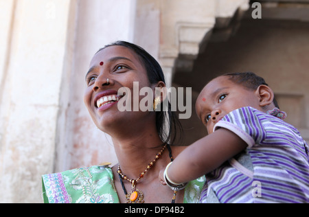 Young mother with child  in Jaipur,Rajasthan,India. - Stock Photo