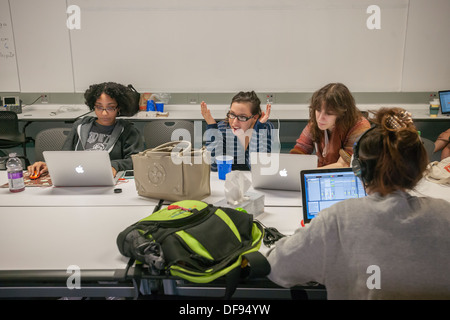 Participants collaborate on developing computer games at a game jam