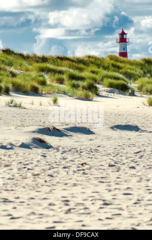 lighthouse behind beach and dunes on Sylt - Stock Photo
